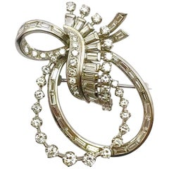 Round Brilliant and Baguette Diamond Platinum Double Bow Pendant Brooch