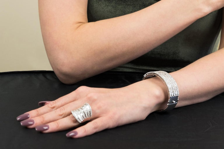 Statement ring, stunning 18 ct white gold ring studded with both round brilliant cut diamonds and baguette cut diamonds, all glistening structured in a gorgeous compact sequence of sophisticated tiers of diamonds one after the other. This ring is at