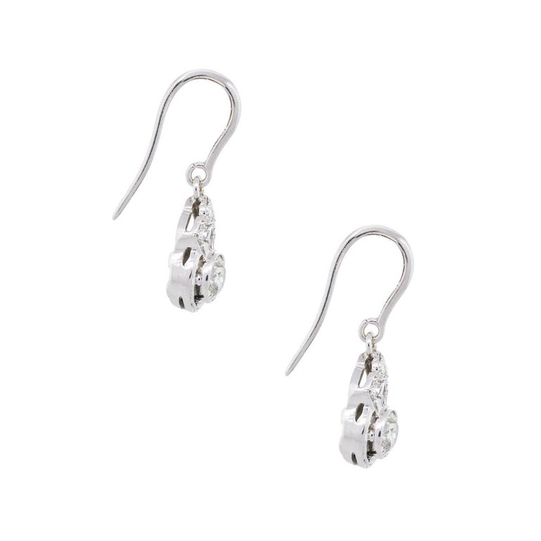 Material: 14k white gold Diamond Details: Approximately 1.25ctw of round brilliant diamonds. Diamonds are G/H in color and SI in clarity. Earring Measurements: 0.94″ x 0.19″ x 0.30″ Earring Backs: Hooks Total Weight: 3.2g (2.1dwt) Additional