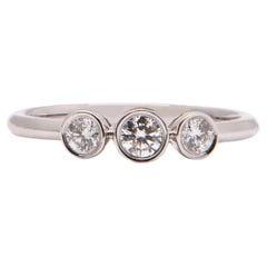 Round Brilliant Cut Diamond Trilogy Ring in 18 Carat White Gold