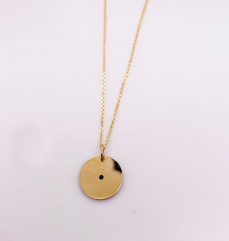 Gorgeous Diamond Disk Necklace! 14 Karat Yellow Gold disk necklaces are huge in fine jewelry fashion! You can find them in every magazine. This diamond necklace is the perfect gift for any occasion and has a beautiful satin finish! With an