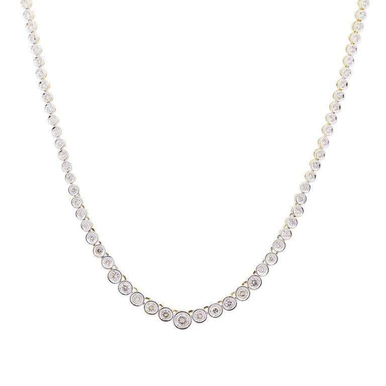 Material: 18k white and yellow gold Diamond Details: Approximately 3ctw of graduated round brilliant diamonds. DIamonds are I/J in color, SI1 - SI2 in clarity Measurements: Necklace measures 16″ Fastening: Tongue in box clasp with safety latch Item