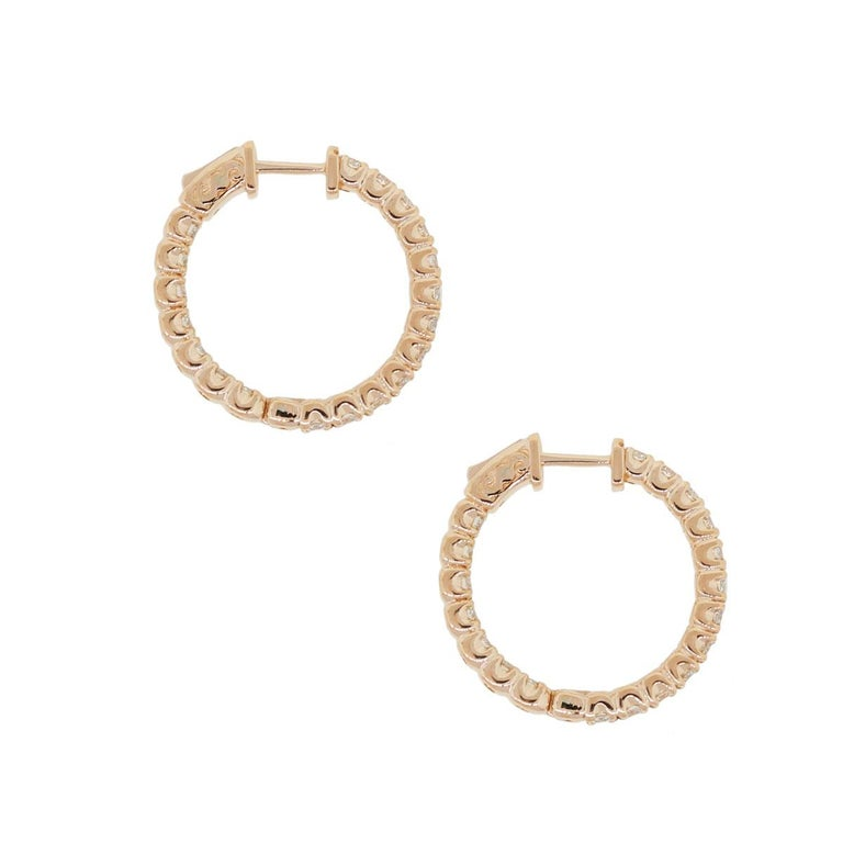 Material: 14k rose gold Diamond Details: Approximately 2.38ctw of round brilliant diamonds. Diamonds are G/H in color and VS in clarity. Measurements: 0.99″ x 0.14″ x 0.99″ Earring Backs: Hinged Backs Item Weight: 9.5g (6.1dwt) Additional Details: