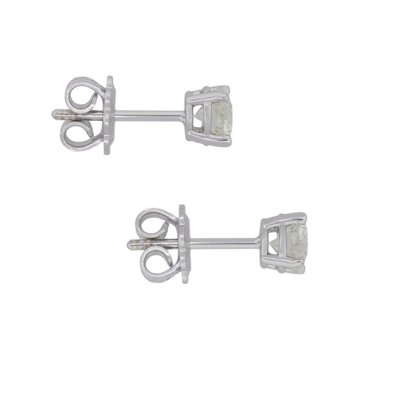 Material: 14k white gold Diamond Detail: Approximately 1.33ctw of round brilliant diamonds. Diamonds are I/J in color, I1 in clarity Measurements: 0.59″ x 0.20″ x 0.20″ Earrings Backs: Post friction Total Weight: 2g (1.3dwt) Additional Details: This