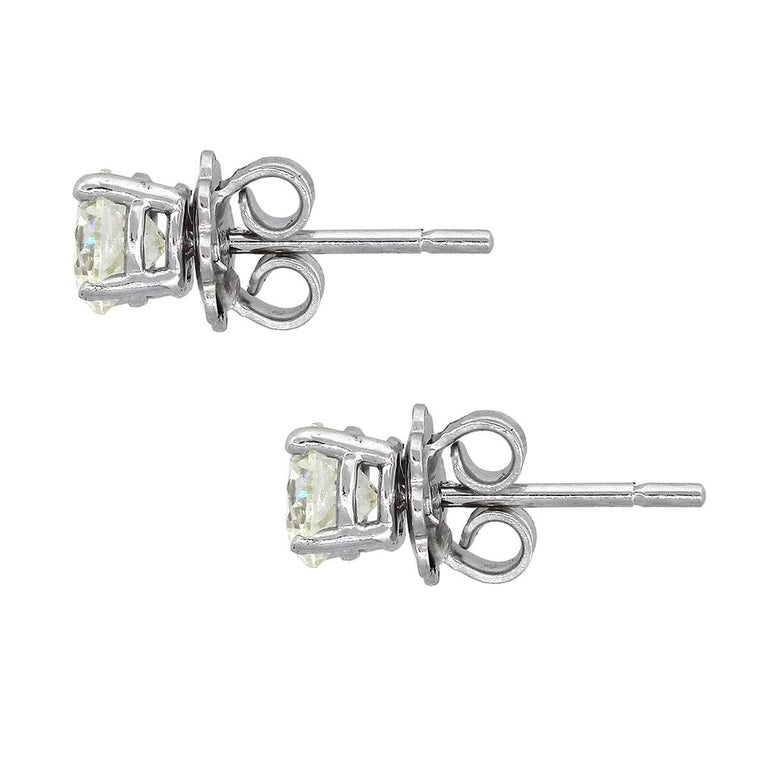 Material: 14k white gold Diamond Details: Approx. 1.55ctw of round brilliant diamonds. Diamonds are G/H in color and SI in clarity Measurements: 0.60″ x 0.22″ x 0.22″ Earrings Backs: Tension post Total Weight: 2.1g (1.4dwt) SKU: A30312447