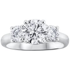 Round Brilliant Diamond Three-Stone Engagement Ring in Platinum