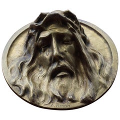 Round Bronze Wall Plaque Depicting a Suffering Christ in Tears by Sylvain Norga