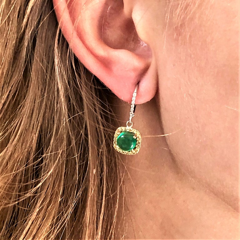 Fourteen karat white gold drop hoop earrings with cabochon emerald, yellow sapphire and diamonds Round shape cabochon emerald weighing 3.40 carat  Diamond weighing 0.20 carat  Yellow Sapphire weighing 0.35 carat  Earrings measuring 1.5 inch long