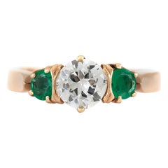 Round Center Diamond with Two Side Round Emerald Ring