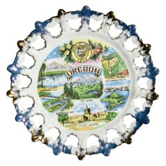 Round Ceramic Decorative Souvenir Tourist Plate from Oregon in Blue and Gold