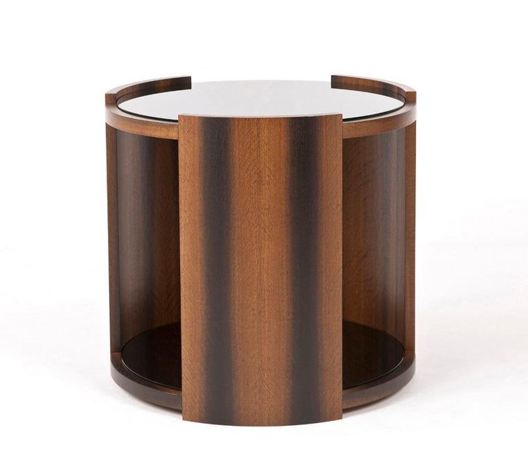 Modern round coffee table with a black glass internal shelf and black glass top.  The table photographed has been made with bog oak veneer to soften the sleek black glass top and shelf. It has a diameter of 600mm and us 650mm in height.  These