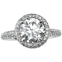 Round Cut Diamond Engagement Ring with Pavé Halo and Shank in White Gold