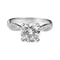 Round Cut Solitaire Diamond Engagement Ring with Twist Design Setting
