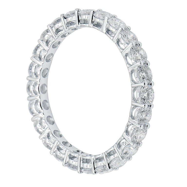 This gorgeous classic eternity band is perfect for everyone. This ring is made from 1.7 grams of 18 karat white gold. 23 beautiful VS2, G color diamonds totaling 1.85 carats are set all the way around the band for the perfect balance of gold to
