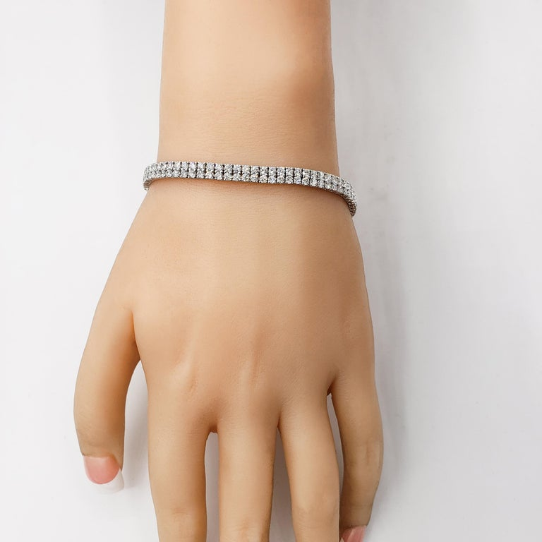 Features two rows of round cut diamonds weighing approximately 5.62 carats total. Each diamond set in a traditional four prong setting made in 18k white gold. Approximately 7 inches long.