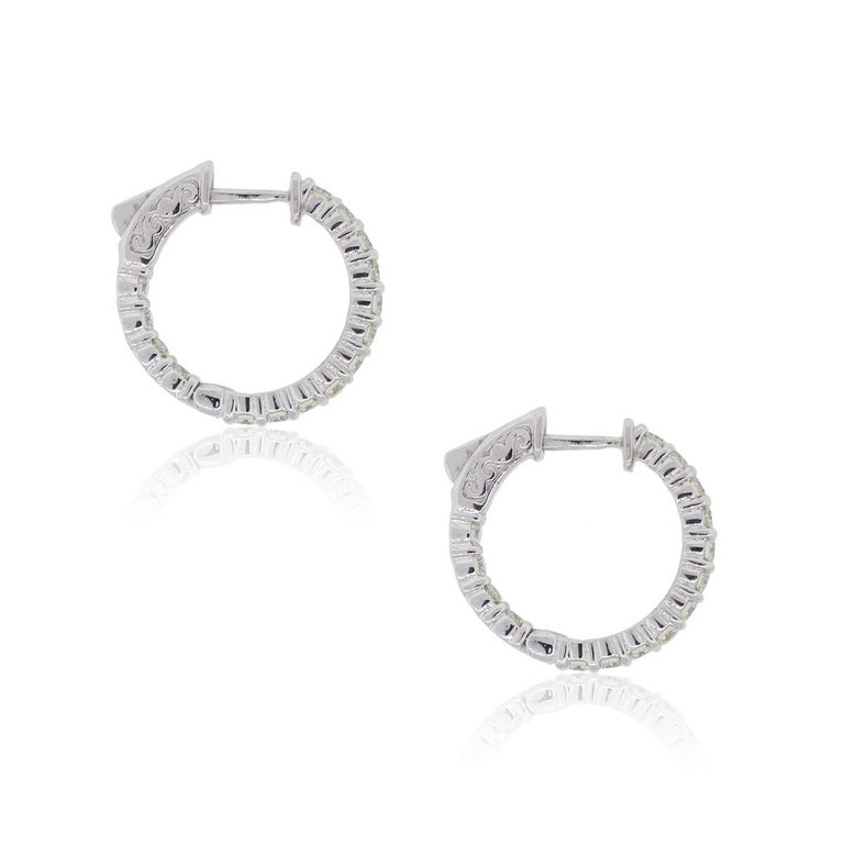 Material: 14k white gold Diamond Details: Approximately 1.41ctw of round brilliant diamonds. Diamonds are G/H in color and VS in clarity. Measurements: 0.81″ x 0.12″ x 0.79″ Earring Backs: Hinged Backs Item Weight: 5.2g (3.4dwt) Additional Details: