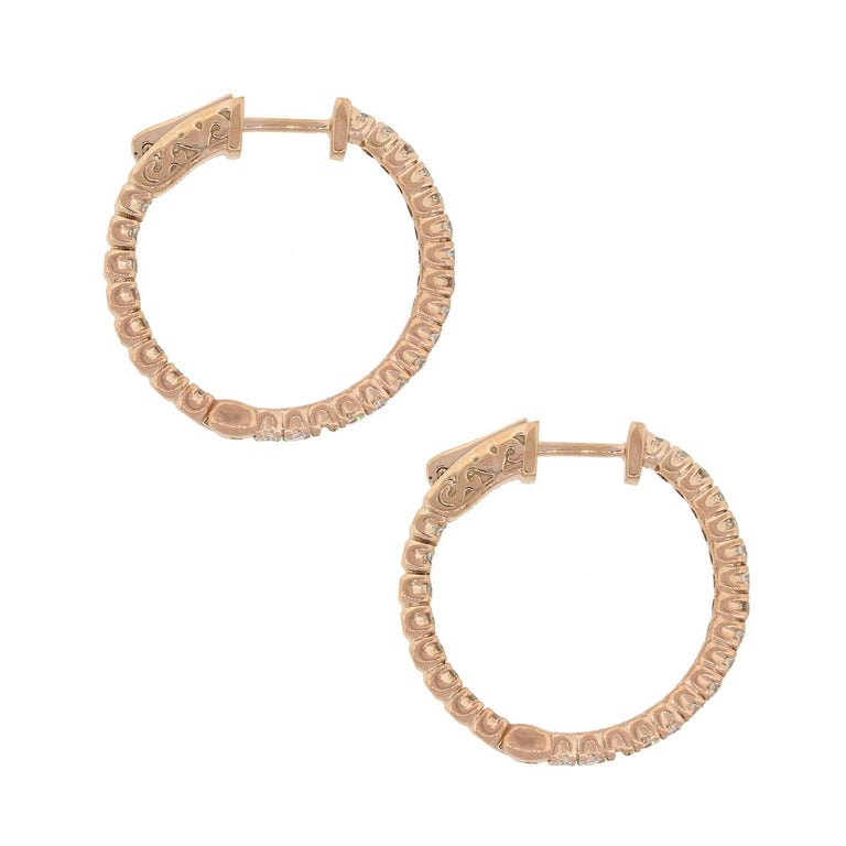 Material: 14k Rose Gold Style: Diamond Inside Out Hoops Diamond Details: Approximately 1.19ctw of round brilliant diamonds. Diamonds are G/H in color and SI in clarity. Earring Measurements: 0.95″ x 0.11″ x 0.95″ Total Weight: 6.3g (4.1dwt) Earring