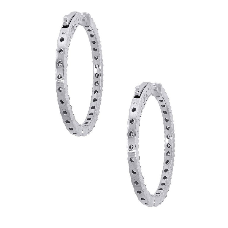 Material: 14k white Gold Style: Diamond Inside Out Hoops Diamond Details: Approximately 2.87ctw of round brilliant diamonds. Diamonds are G/H in color and SI in clarity. Earring Measurements: 1.25″ x 0.11″ x 1.25″ Total Weight: 9.5g (6.1dwt) Earring