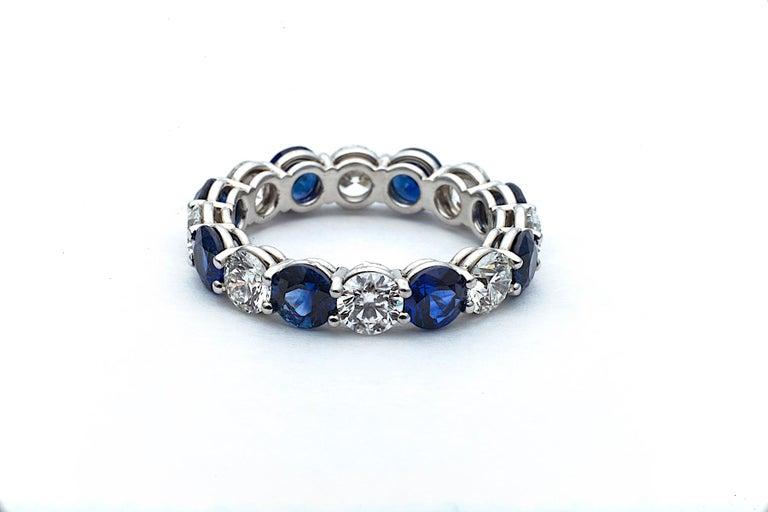 Modern Round Diamond Sapphire and Platinum Band Ring
