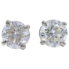 Round Diamond Solitaire Stud Earrings 2.03 Carat Set in 14 Karat White Gold