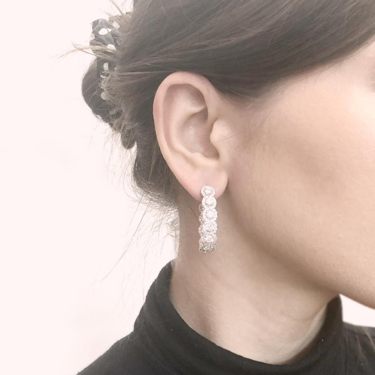 Elegant diamond half loop earrings with brilliant round cut diamonds 7.23 carat total all over.  Diamonds are white and natural and in G-H Color Clarity VS. 18 karat gold metal.  Elegant and contemporary style earrings.