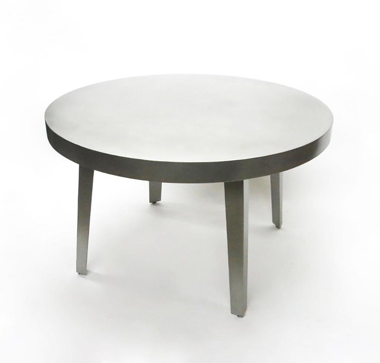 Round dining or center table of strong quality in brushed stainless steel with a 3 1/8