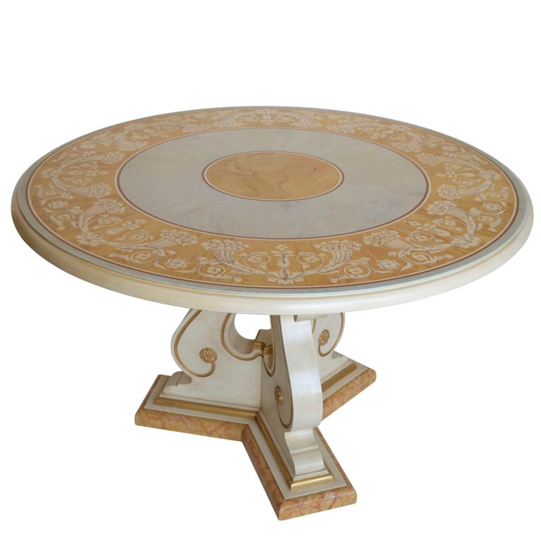 Verbena round dining or center table This table with scagliola art inlay takes inspiration from the classical paliotto with a frame of cornucopias but the choice of colors, Siena yellow and light blue give a sophisticated effect to this romantic