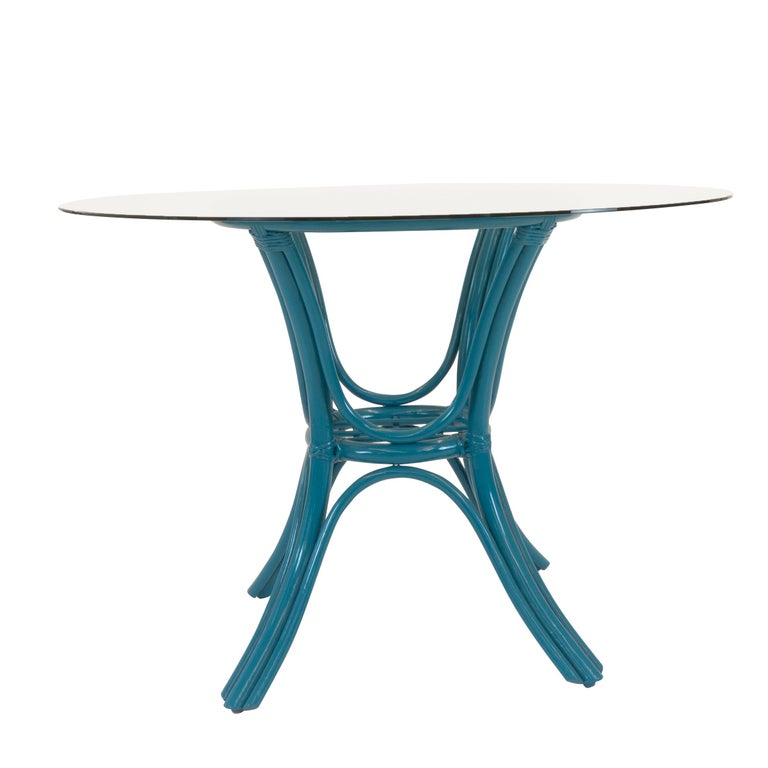Round Dining Table with Rattan Base In Excellent Condition For Sale In Greenwich, CT
