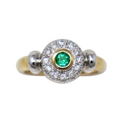 Round Emerald Bezel Set and Pave Diamond Halo Ring in Two Tone 14 Karat Gold