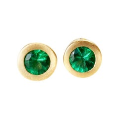 Round Emerald Stud Earrings in 18 Karat Yellow Gold