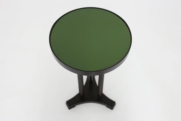 Hand-Carved Round End Table with Painted Olive Green Glass Top and Dark Mahogany Base For Sale