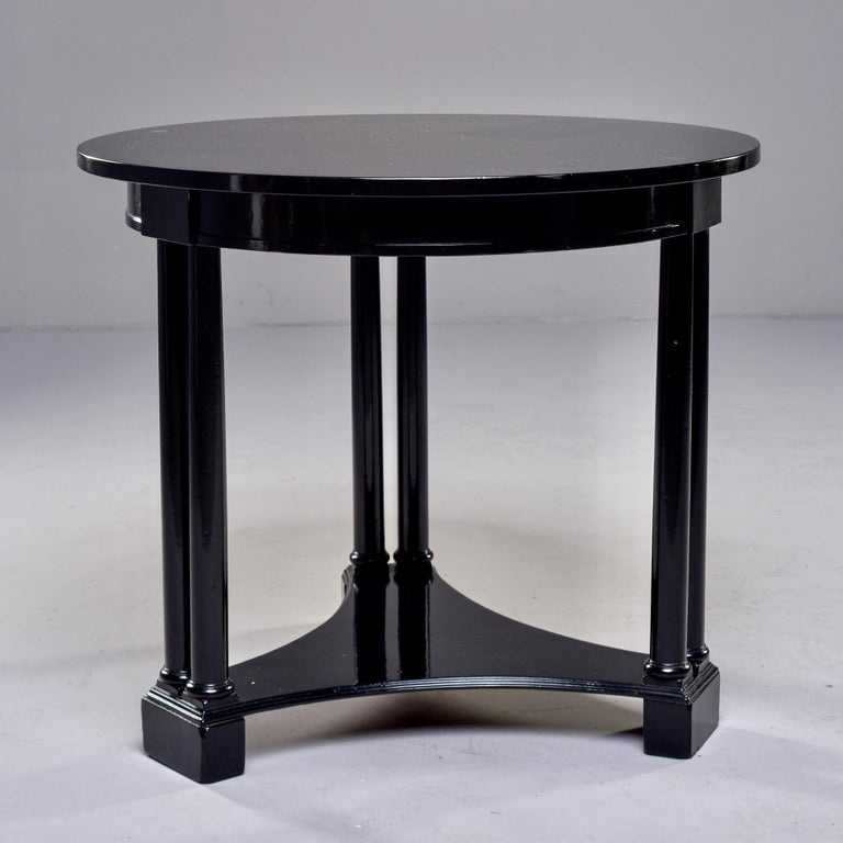 Circa 1930s French Art Deco side table has round top and three leg pedestal base with a new ebonised finish. Unknown maker.