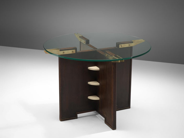 Side table, lacquered wood, glass and brass, France, 1950s.  This gueridon table features a robust, late Art Deco style base. The frame is made of darkened wood, with white lacquered details in the middle. The top is finished with brass supports.