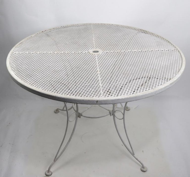 Stylish round garden or patio dining table with wrought and cast iron base, and mesh top. Currently in old white paint finish, usable as is or we offer custom powder coating if you prefer a more polished look.