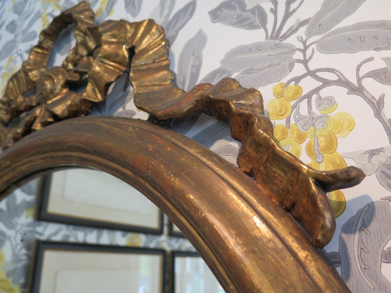 20th Century Round Gilded Mirror Adorned with Bow For Sale