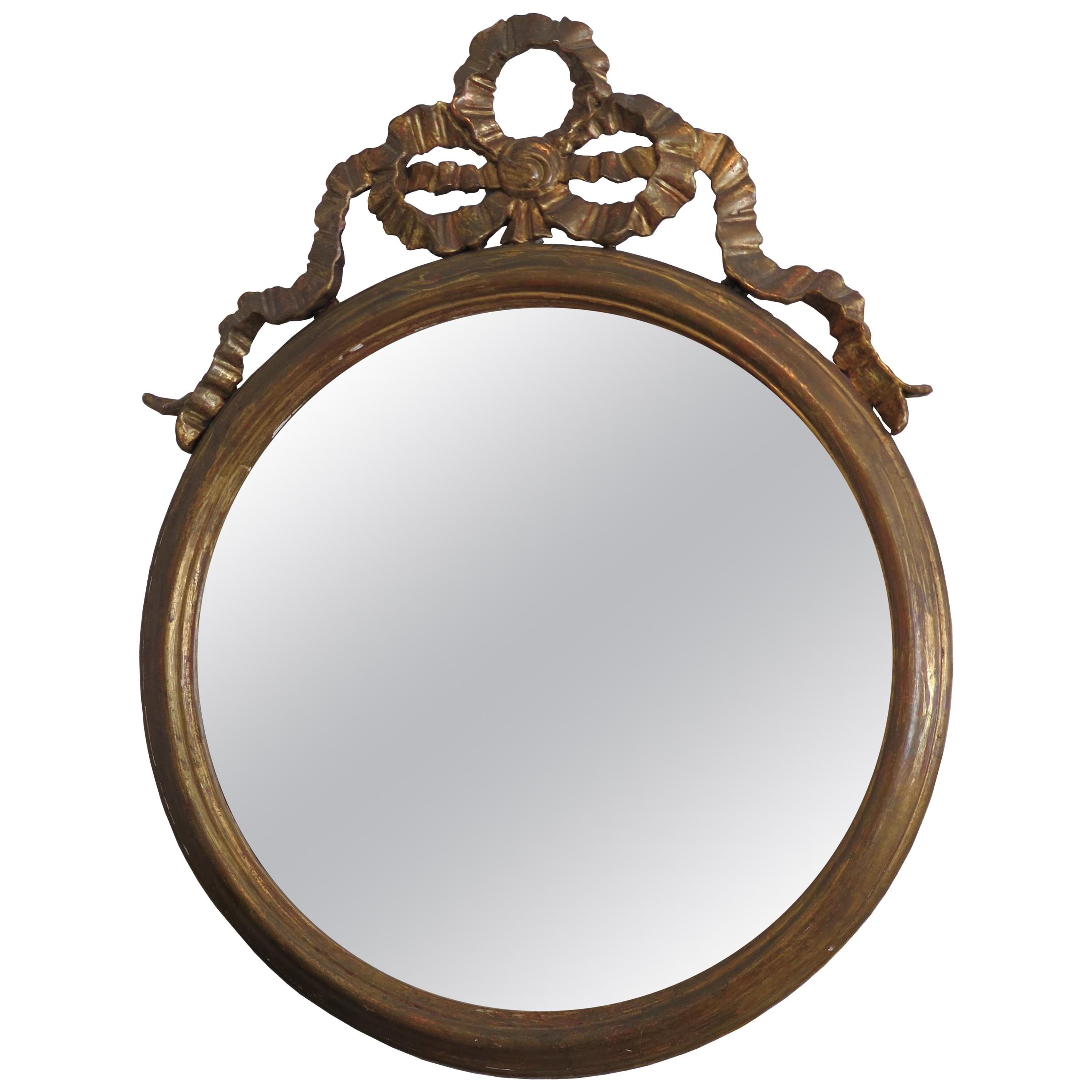 Round Gilded Mirror Adorned with Bow