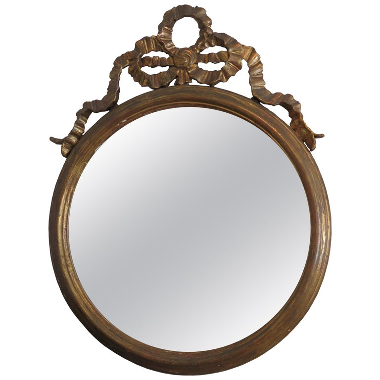 Round Gilded Mirror Adorned with Bow For Sale