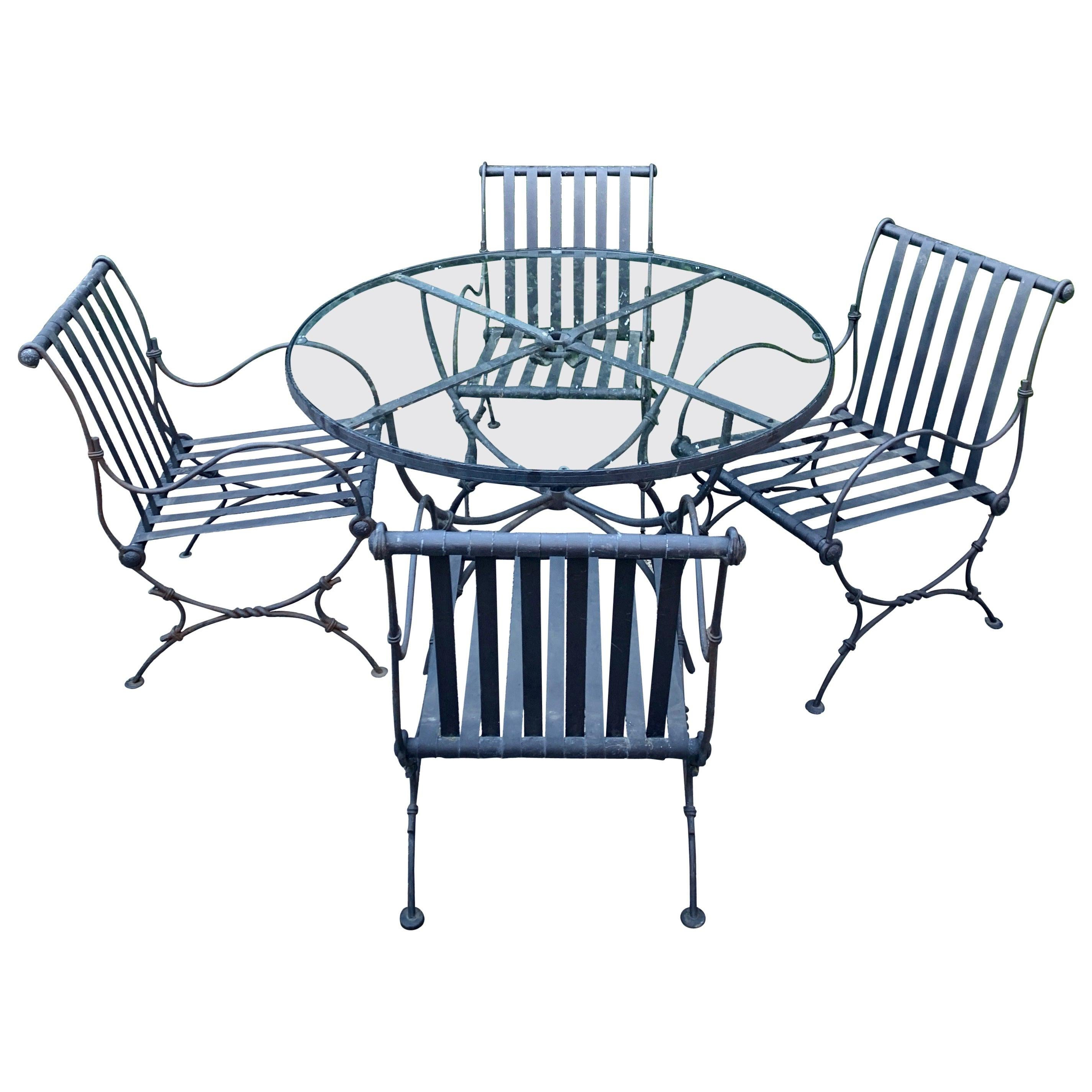 Round Glass Top Iron Patio Table with Four Chairs