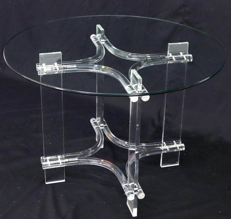 Mid-Century Modern Lucite base glass top round dinette dining table.