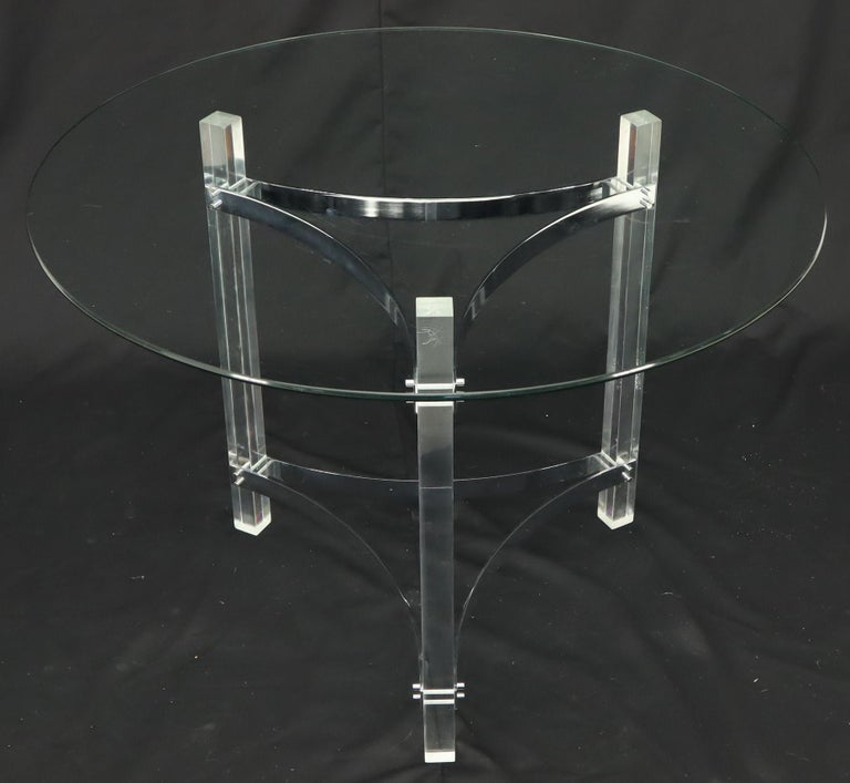Mid-Century Modern small round dining center table. Chrome and Lucite tripod base. In the style of Pace.