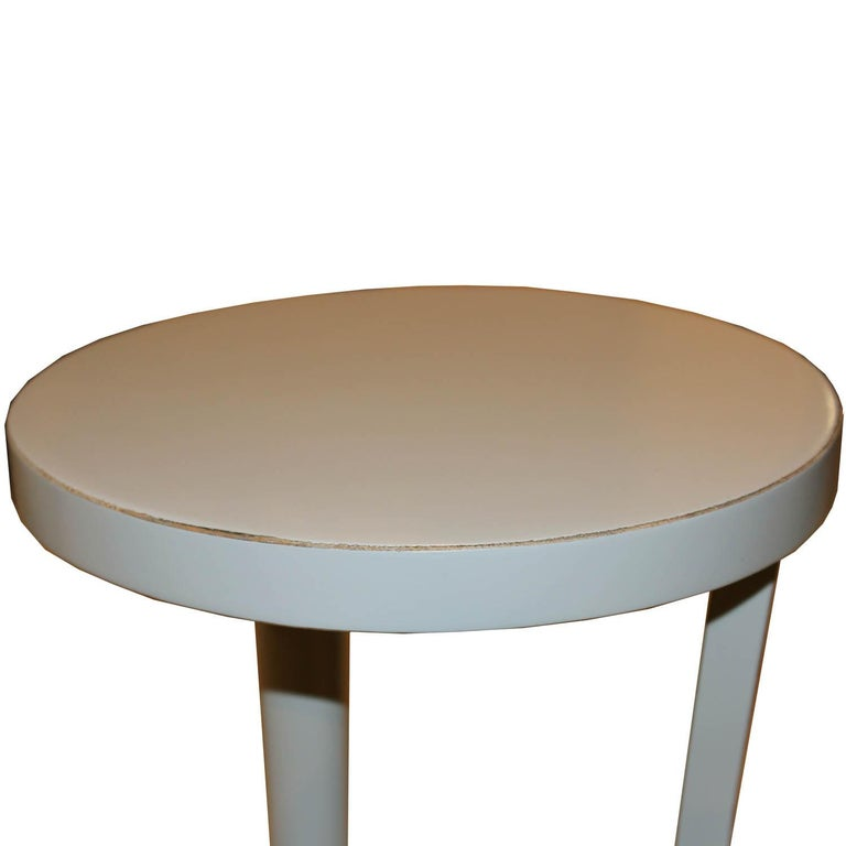 Contemporary small round cocktail table with exposed wood edges can be used as a coffee table or side tables next to an armchair.