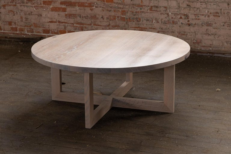 Solid wood from the urban forest imbues this round wood coffee table in grey urban oak with a unique grain and texture. A full 48