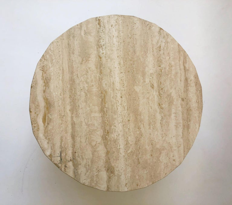 """Round Italian travertine cocktail table in the manner of Willy Rizzo. The table has been newly professionally polished. It can take up to 60"""" in diameter glass top to make it bigger. Measurements: 24"""" diameter 16"""" high."""