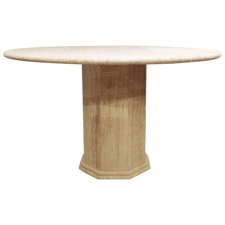 Beautiful dining table made from travertine stone.  Beautiful travertine material with the natural 'holes' in the stone.  Nicely finished round top.  Good condition  1970s - Italy  Measures: Height 74cm/29.13