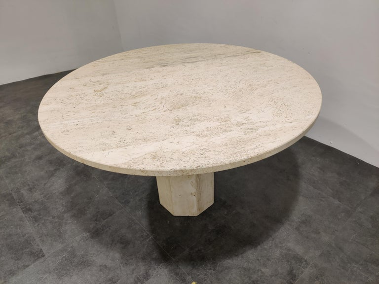 Beautiful dining table made from travertine stone.