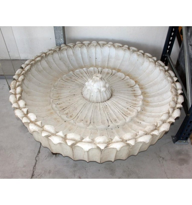 Round marble hand-carved one piece floor fountain.