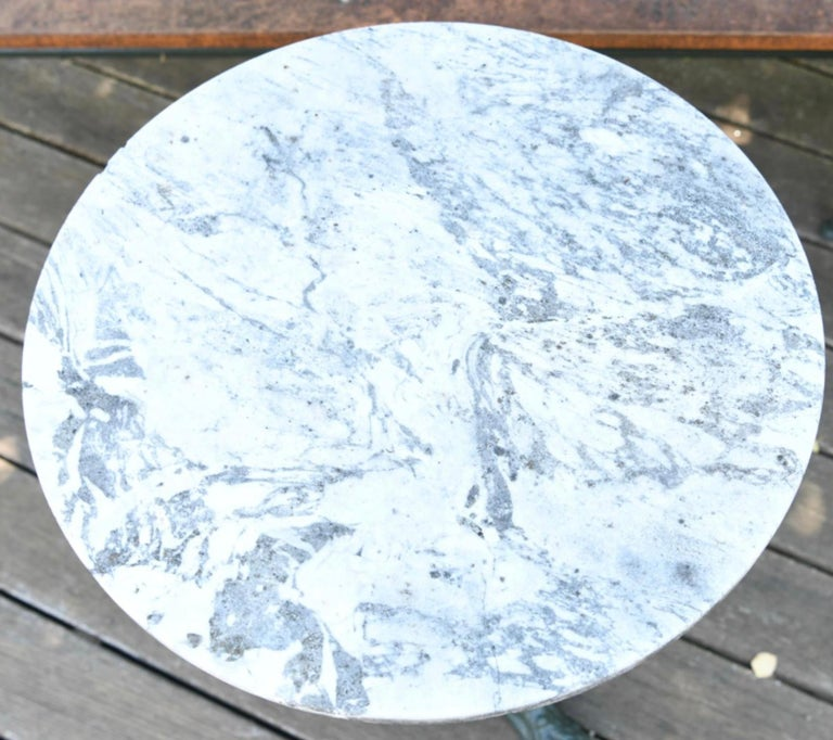 A fine vintage Frenchcafé or bistro table with a round or circular marble top. painted cast iron pedestal base. Great for an indoor or outdoor patio or garden. Dimensions: H 28