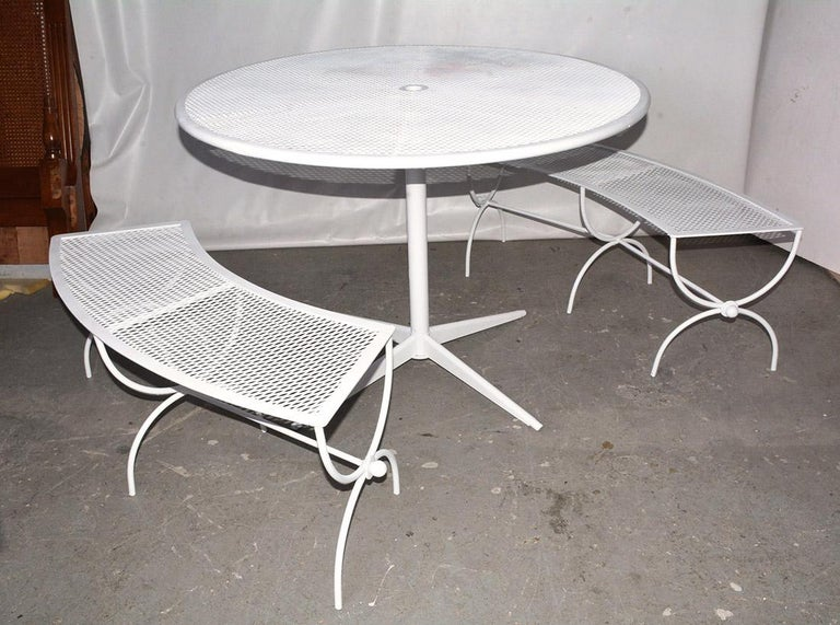 Mid-Century Modern Round Metal Patio Table and Two Matching Benches by Woodard For Sale