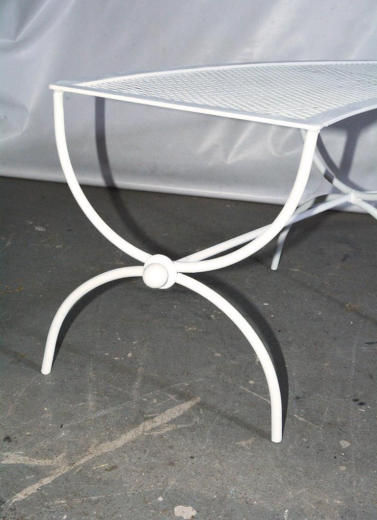 Wrought Iron Round Metal Patio Table and Two Matching Benches by Woodard For Sale