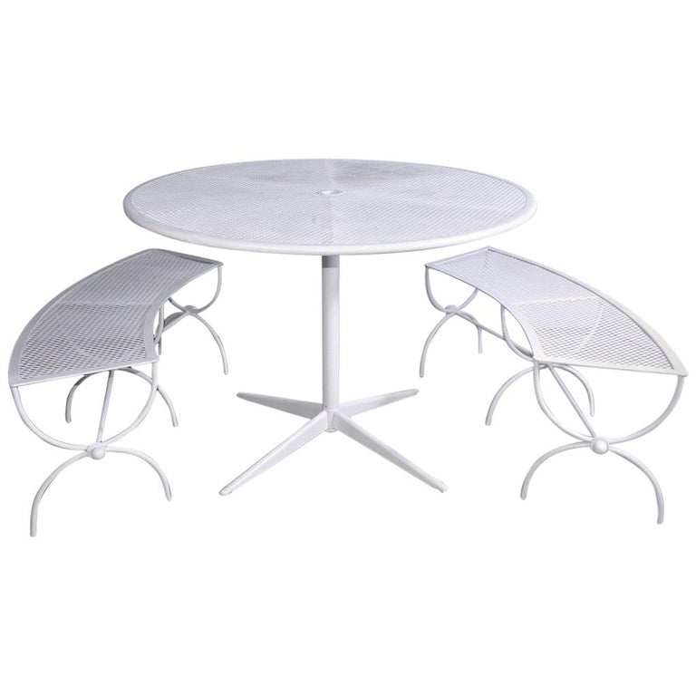 Round Metal Patio Table and Two Matching Benches by Woodard For Sale